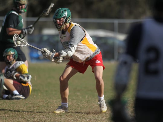 Caleb Gehres and Lincoln's lacrosse team practices on its home field, Wednesday, March 7, 2018.