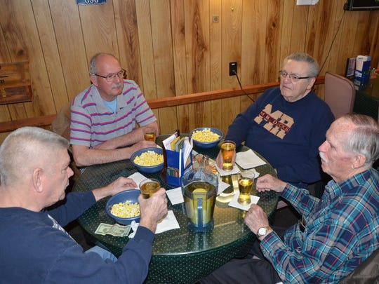 American Legion Captain Oscar Brady Post 298 members, clockwise, Jim Taylor, Jim Kleynenberg, Rich Gagnon and George Beromja, enjoy popcorn and drinks Tuesday.
