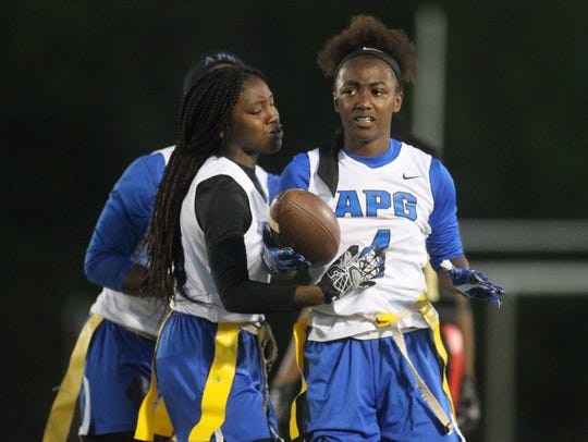 Godby's Armarni Williams (4) is congratulated by teammates