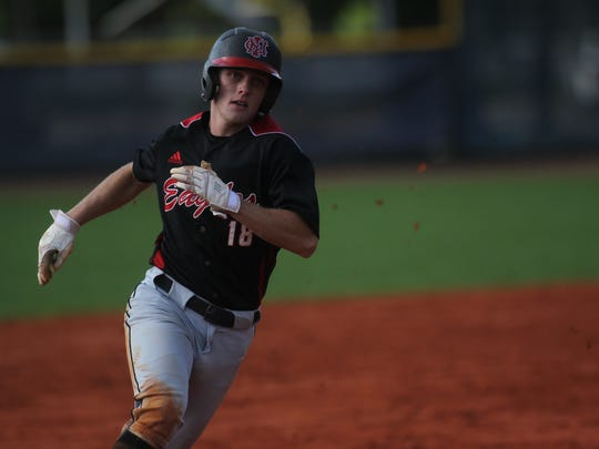NFC's J.D. Tease races around third to score a run against Maclay.