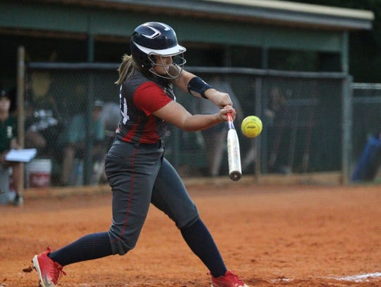 Wakulla's Emery Mayne belts a double against Lincoln.