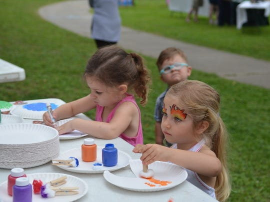 Free face painting and yoga are part of the Bayou Vermilion
