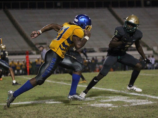 Rickards' Trevor Solomon-Wilson takes off on a pass route during Friday's spring jamboree between Godby, Lincoln and Rickards at Florida A&M's Bragg Memorial Stadium.