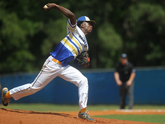 Rickards' Javon Peterson pitches during the Region