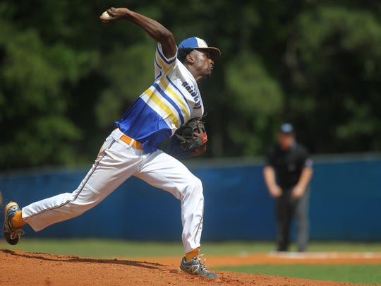 Rickards' Javon Peterson pitches during the Region 1-5A final against Bolles.