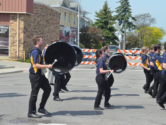 The Port Huron Northern Marching Band makes its way toward Pine Grove Park during the 2018 Port Huron Memorial Day Parade on May 28, 2018, in Port Huron, Michigan.