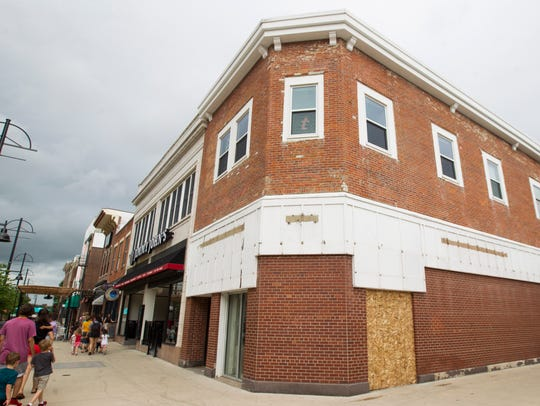 The former Coldstone Creamery storefront sits empty