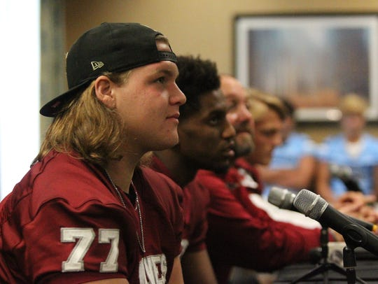 Chiles' Sam Neely listens to a question during the