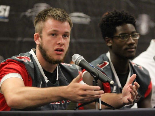 Munroe running back Michael Starling answers a question during the 2018 4QuartersOnline Media Day for high school football.