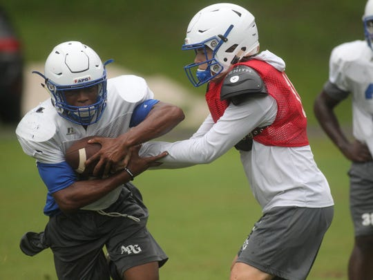 Trey Fisher and the Godby Cougars' football team practices on Thursday, Aug. 2, 2018, in advance of the upcoming fall season.