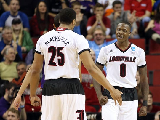Terry Rozier (right) and Wayne Blackshear play against Northern Iowa in their adidas Louisville uniforms, which include sleeves and the aforementioned cummerbund-esque shorts.