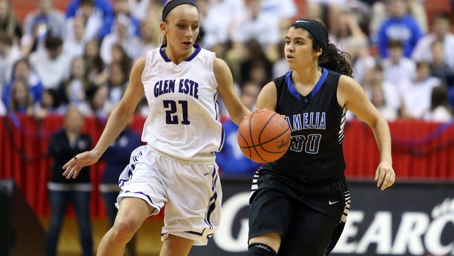 Amelia forward Samantha Lee brings the ball up the court closely guarded by Glen Este forward Courtney Vespie.