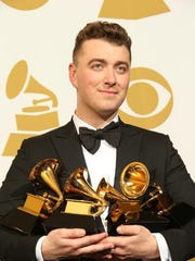 Sam Smith poses with his Grammy Awards at the 57th