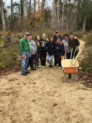 Students from McKinley Academy and their teacher, Gina Wagner, put down the screenings on the trails in Cherney Maribel Caves County Park. This is part of the park restoration that is ongoing since the tornado a few years ago. It is slow going, but with the help of many volunteers, the park is starting to shape up.