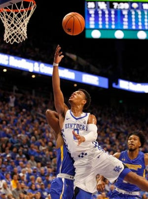 Kentucky Wildcats guard Quade Green (0) shoots the ball against the Morehead State Eagles in the first half at Rupp Arena.