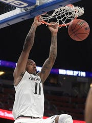 Cincinnati forward Gary Clark (11) dunks the ball during the first half of an NCAA college basketball game against Memphis in the semifinals at the American Athletic Conference tournament Saturday, March 10, 2018, in Orlando, Fla. (AP Photo/Phelan M. Ebenhack)