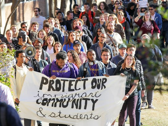 Over 100 protesters march from the Cooper Library to