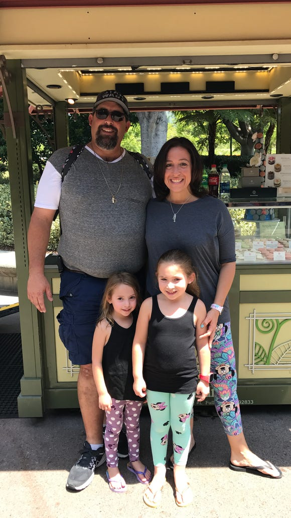 Adorable family with little girls decked out in adorable Minnie-print leggings from LulaRoe, purchased at Disney's D23 Expo at Anaheim Convention Center. Credit: Sharon Fisher
