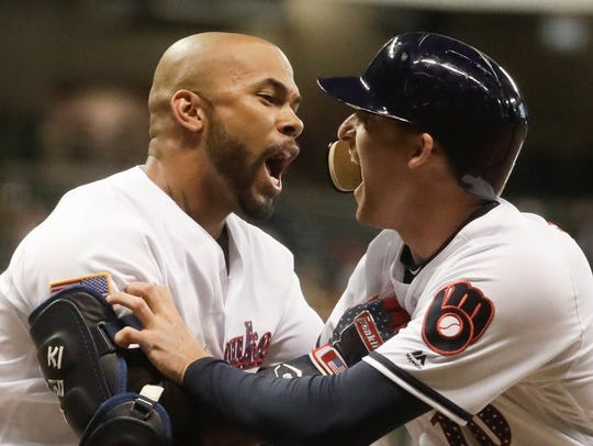 The Brewers' Brad Miller (right) is congratulated by