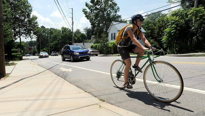 State officials would be barred from allowing conversion of lanes on state roads under some circumstances under a bill the legislature is discussing. A bicyclist peddles up Clingman Avenue in the bike lane Tuesday.
