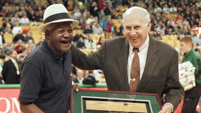 "Rudy ""Spider"" Edwards, left, retiring after working as a custodian for 33 years at both the old Boston Garden and the Fleet Center, receives a piece of the parquet floor from Celtics legend Red Auerbackhin Boston, Friday, Nov. 28, 1997."