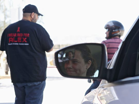 Yolanda Lozano waits in line to take her driving test at the DMV in Palm Desert.