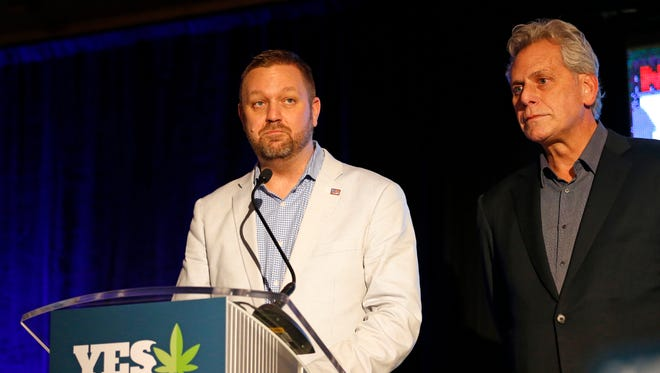 Ian James, executive director of ResponsibleOhio, and Jimmy Gould, founder of ResponsibleOhio, speak to the crowd at Le Meridien The Joseph in Columbus after Issue 3 was rejected Tuesday night.