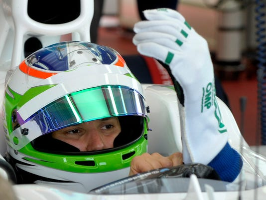 Simona De Silvestro, of Switzerland, sits in the cockpit of a Sauber F1 2012 during a training session at Ferrari's Fiorano test track, near Modena, Italy, Saturday, April 26, 2014. Simona de Silvestro is an affiliated driver with Sauber this year with a goal of competing for a Formula One seat in 2015. The Swiss driver has spent the last four years racing in IndyCar, and scored her first career podium in October with a second-place finish at Houston. It was the first podium finish for a woman on a road course in IndyCar. The 25-year-old De Silvestro has been spending this year testing, participating in simulator training and preparing for the mental and physical demands of F1. Sauber says the goal is to help De Silvestro earn her F1 super license and prepare for a seat in 2015. (AP Photo/Marco Vasini)