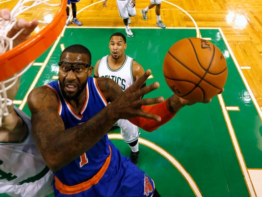 New York Knicks' Amar'e Stoudemire goes to the basket as Boston Celtics' Jared Sullinger looks on during the second quarter of an NBA basketball game in Boston Friday, Dec. 12, 2014. (AP Photo/Winslow Townson)