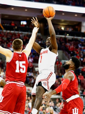 Ohio State Buckeyes forward Jae'Sean Tate (1) shoots a fall away jumper over Indiana Hoosiers guard Zach McRoberts (15) during the first half at Value City Arena.