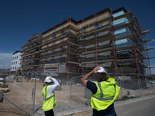 Winds pick up while Moira Bright, senior vice president of development with Spirit Hospitality, left, and Studio PBA director of hospitality Edwin Mocke walk around the site on Tuesday, April 17, 2018. Spirit Hospitality is building a Fairfield Inn and Suites at Lady Moon Drive and East Harmony Road in Fort Collins. The hotel is expected to open in late summer 2018.