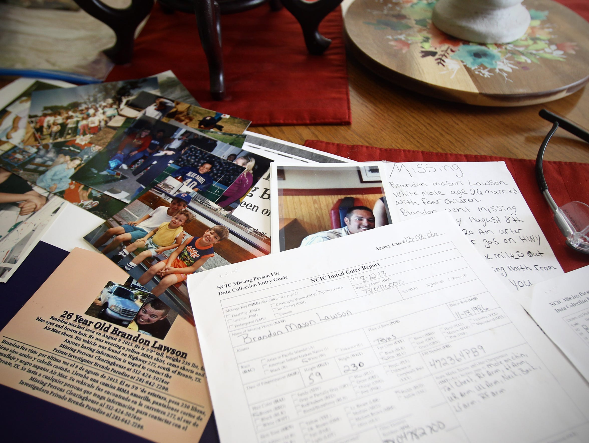 Pictures and a missing persons report line the kitchen