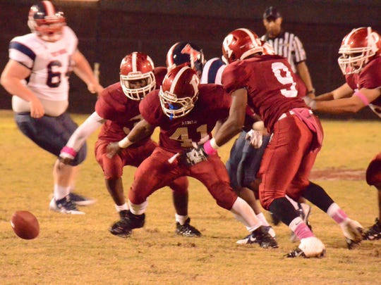 Pineville senior Shaquille Harbor (9) pursues a fumble against West Monroe that teammate Jacob Joffrion (41) scooped up and scored. Harbor, a transfer from Iowa who began the season at running back, moved to nickel back for the Rebels two weeks ago.