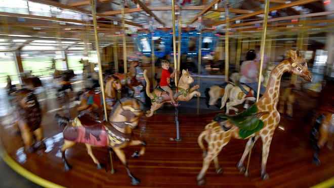 Three-year-old Weston Wilson of Belpre, Ohio, enjoyed multiple rides at the Richland Carrousel Park on Thursday afternoon.
