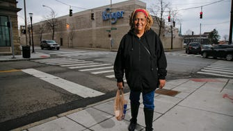 Gwendolyn Beamon, pictured, Wednesday, Feb. 22, 2017, at the corner of Kemper and McMillan streets in Walnut Hills in Cincinnati, was born and raised in Walnut Hills and returned 7 years ago. She now lives near the Kroger and shops there several times a week.