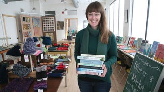 Mary Morgan organizes a pop-up bookstore and market at 702 W. Johnson St. in Madison. Morgan owns Reading Group Choices, a business that compiles lists of questions for reading groups to use when they discuss books and also publishes an annual list of books reading groups might want to read. Reading Group Choices' office is located at 702 W. Johnson St. Select books, art, handmade clothing and selected antiques were being sold at the pop-up store.