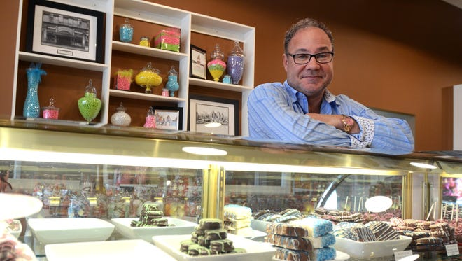 Owner Todd May talks about moving to the new store and the bigger space Monday, Feb. 1, at the new location of the Sweet Tooth in downtown Marine City.