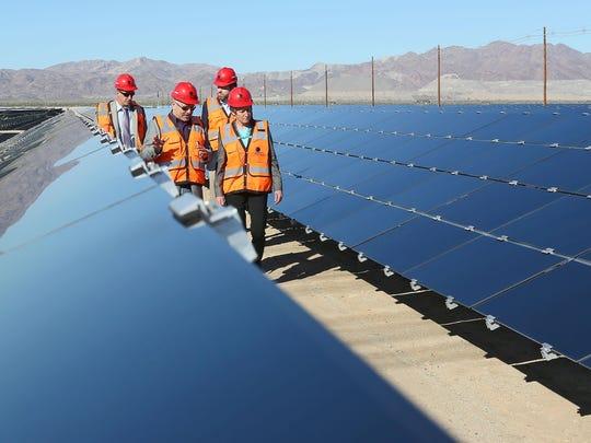Interior Secretary Sally Jewell, right, tours the 550-megawatt Desert Sunlight solar plant on federal land in Riverside County, California on Feb. 9, 2015.