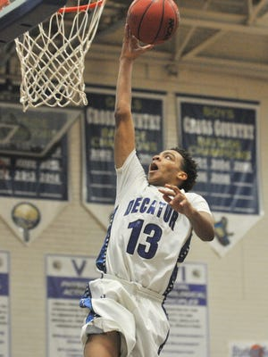 Stephen Decatur's Kevon Voyles scores two against Northeast during a playoff win on Monday in Berlin.