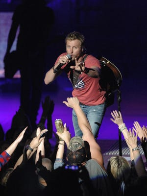Dierks Bentley, pictured on stage at the PNC Bank Arts Center in 2014, returns to the Holmdel amphitheater this weekend.