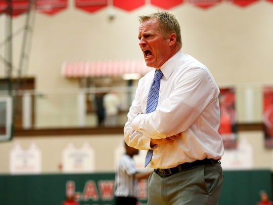 Then-Carmel head girls basketball coach Tod Windlan got after his team during a game against Larence North on Dec. 1, 2015.