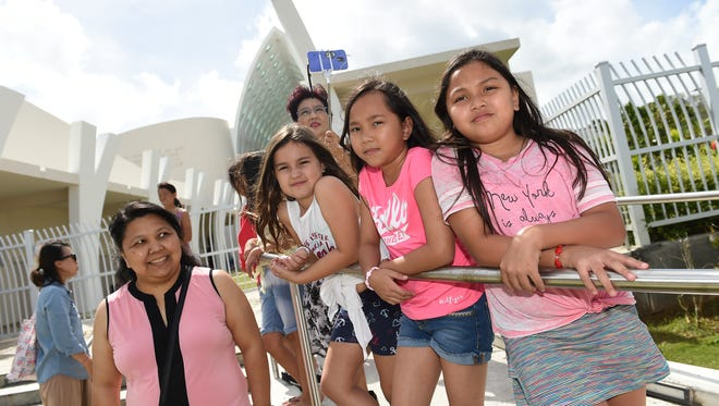 Kids gather outside the Guam Museum during a Ha'ånen Familia kite-making class on Jan. 13, 2018.