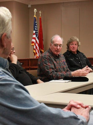 Board member Truman Murray discusses a proposed referendum at a meeting Tuesday between members of the School Board and the Madison County Commission.