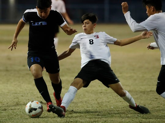 At right, Palm Springs High School's Sebastian Duran defends against Jose Hernandez of Cathedral City High School on January 30, 2018.