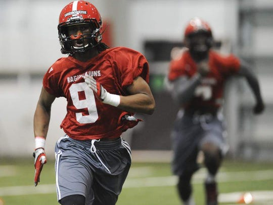 UL defensive back Kamar Greenhouse takes part in drills during a March 2015 practice.