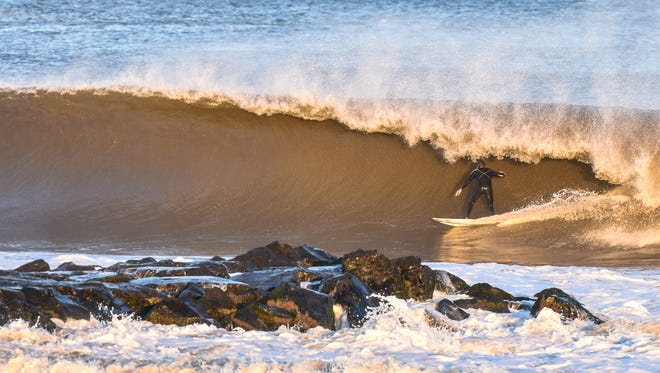 Surf icon Kelly Slater rides a wave at a southern Monmouth County beach.