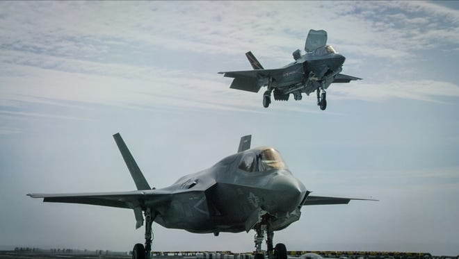 "F-35B fighters make a vertical landing aboard a Nimitz-class aircraft carrier during the Rim of the Pacific maritime exercises. Audiences get an up-close and personal look at this next generation aircraft during the film ""Aircraft Carrier."""