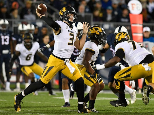 FILE - In this Oct. 28, 2017 file photo, Missouri quarterback Drew Lock (3) throws against Connecticut during an NCAA college football game in East Hartford, Conn. Tennessee has allowed just 150 yards passing per game to rank fourth nationally, but the Volunteers aren't sure exactly how strong their pass defense is because teams don't throw against them very often. The Vols should learn whether their pass defense is as good as its ranking Saturday when they face Lock, whose 31 touchdown passes lead the nation. (AP Photo/Jessica Hill, File)