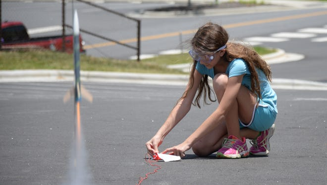 Taleigh Verrault, a rising seventh-grader at Scotts Creek Elementary, launches her model rocket during SCC's Summer STEM Academy at the Jackson Campus in Sylva.