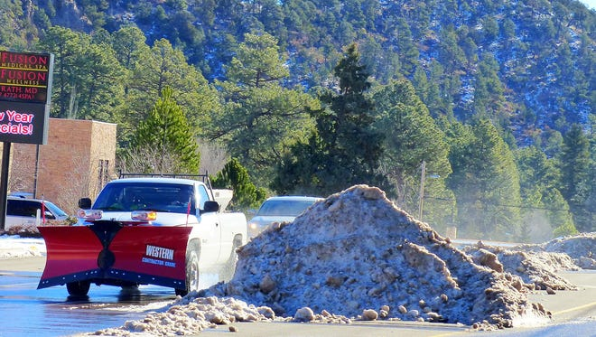 Dreaming of good snow years, most Ruidoso locals would enjoy seeing snow deep enough to require piling it in the middle of the street to clear traffic.